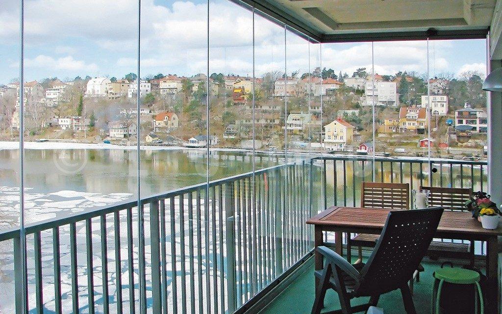 Fermeture en verre sur balcon avec vue panoramique